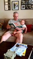 Pop Pop reading to Clark